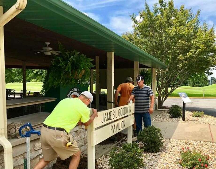 A city of Alton crew installs a sign outside the James L. Goodwin Memorial Pavilion on Wednesday. Photo:       For The Telegraph