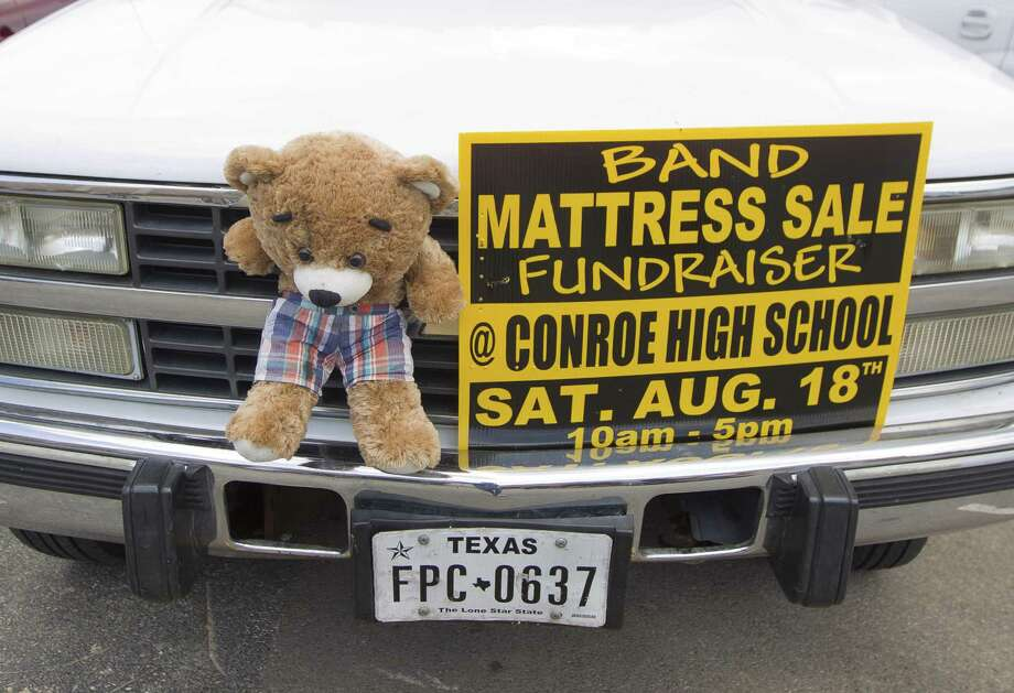 A sign promoting the Conroe High School band's fundraiser is seen on a student's vehicle before practice at Conroe High School on Tuesday, Aug. 7, 2018, in Conroe. Photo: Jason Fochtman, Staff Photographer / Houston Chronicle / © 2018 Houston Chronicle