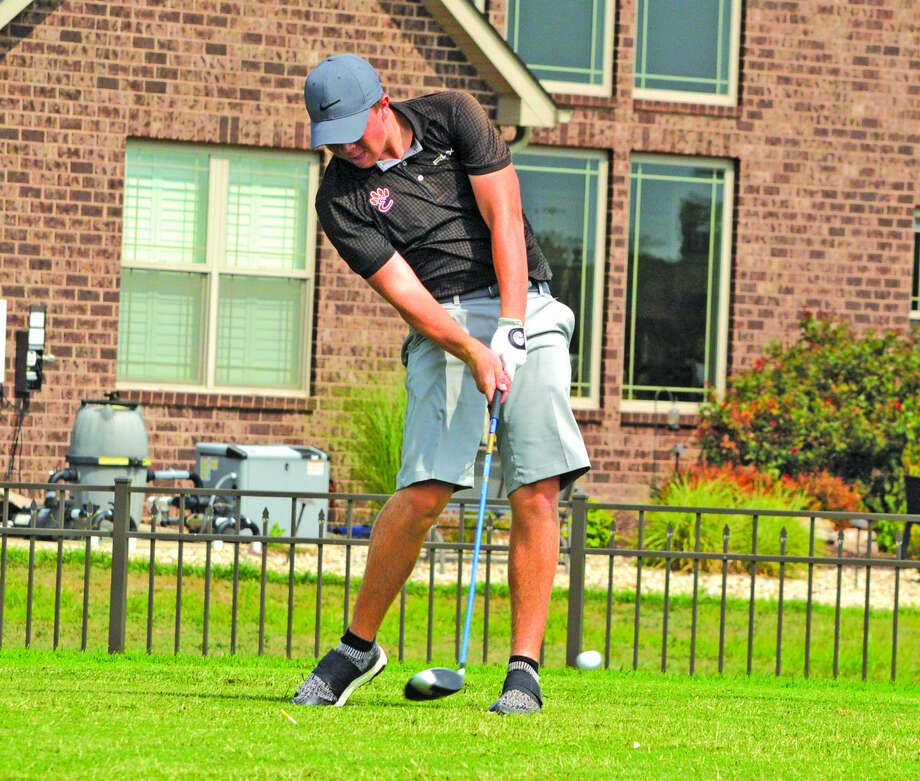 Edwardsville junior Trevor Laub hits a tee shot on hole No. 17 during Monday's practice at Oak Brook Golf Club. Photo: Scott Marion