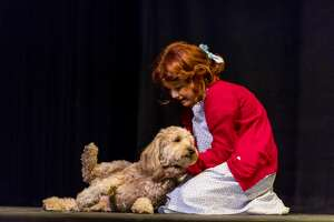The cast of Annie goes through a dress rehearsal on August 1, 2018.