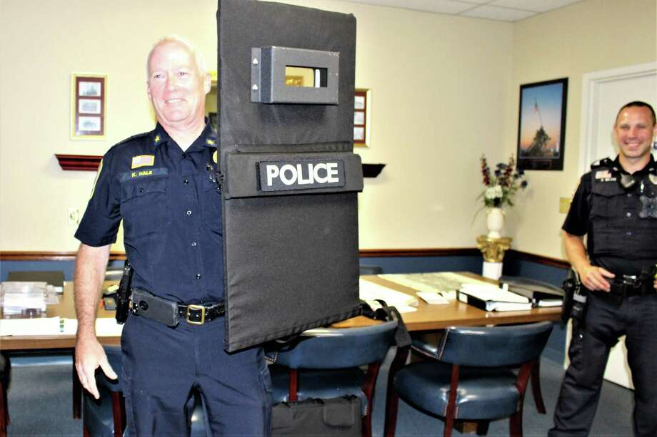 Police Chief Kevin Hale holds up ballistic shield while and Officer Brendon Nelson looks on. Photo: Jean Falbo /