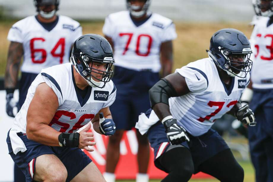 Houston Texans center Nick Martin (66) and guard Zach Fulton (73) run a drill during training camp at the Greenbrier Sports Performance Center on Thursday, Aug. 2, 2018, in White Sulphur Springs, W.Va. Photo: Brett Coomer/Houston Chronicle