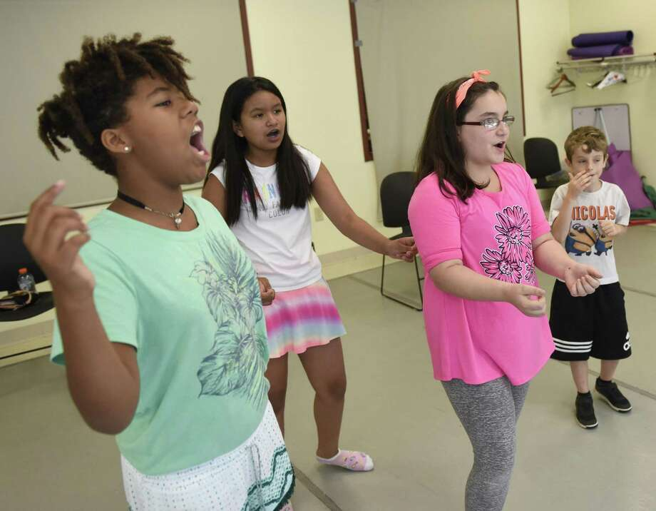 """Theatre camp students, from left, Lily Smith, 9, Emily Elizabeth Cabamero, 10, Kaitlyn Raiente, 11, and Nicolas Abagge, 7, run through the """"A Year with Frog and Toad"""" musical rehearsal at the Western Bendheim Civic Center Tuesday. Photo: Tyler Sizemore / Hearst Connecticut Media / Greenwich Time"""