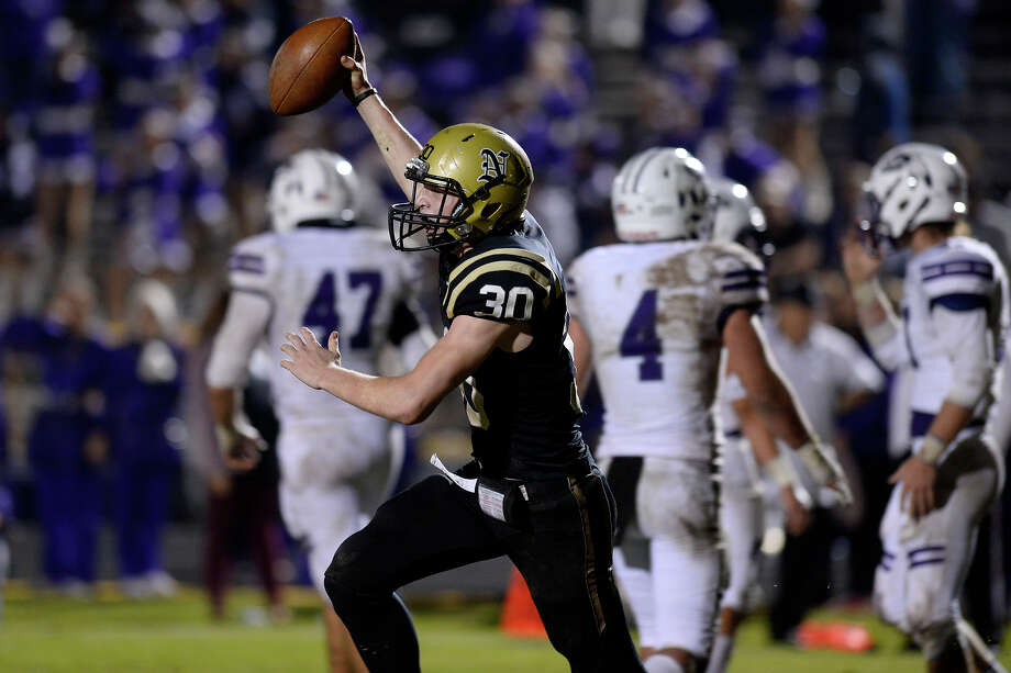 Nederland's Colton Beeson celebrates after scoring the winning two-point conversion during the Mid-County Madness rivalry game against Port Neches-Groves at Bulldog Stadium on Friday night. Nederland won 36-35.  Photo taken Friday 11/10/17 Ryan Pelham/The Enterprise Photo: Ryan Pelham/Ryan Pelham/The Enterprise / ?2017 The Beaumont Enterprise/Ryan Pelham