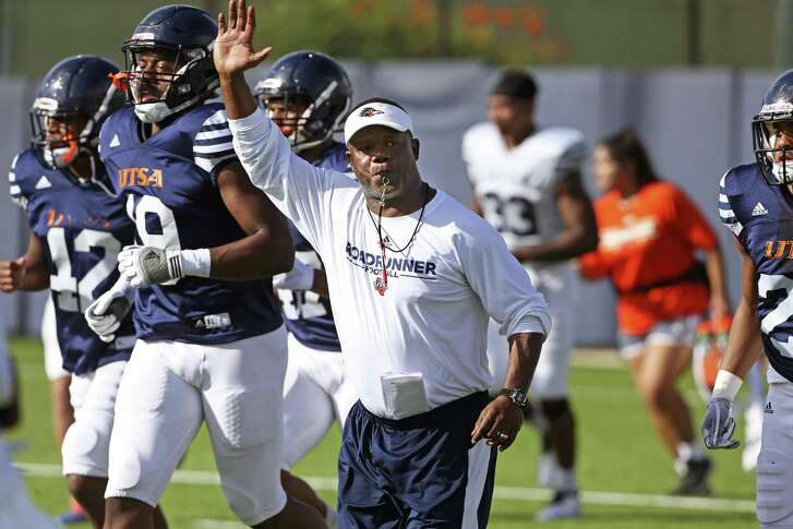 Coach Frank Wilson calls his team to another drill at UTSA football practice on August 8, 2018.