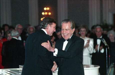 Donald Trump introduces former President Richard Nixon at a 1989 tribute gala to Nellie Connally at the Westin Galleria ballroom.