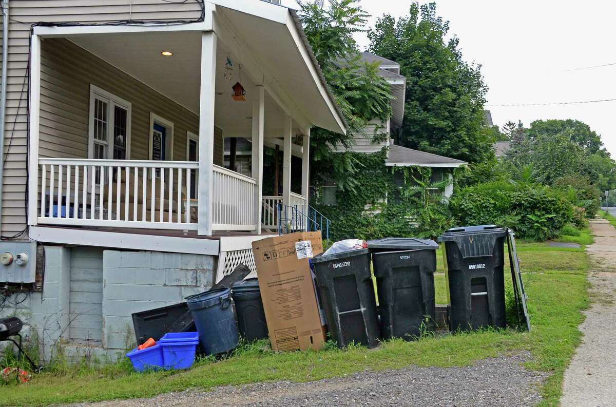 Trash cans outside a house on Oakwood Avenue Tuesday August 7, 2018 in Troy,NY. (John Carl D'Annibale/Times Union)