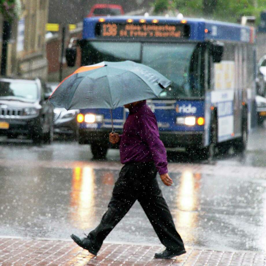 A pedestrian crosses State Street under an umbrella as yet another rain storm hits the region Wednesday August 8, 2018 in Albany, NY.  Monday, Sept. 10, 2018 will bring the first heavy rain the Capital Region has seen since early August. (John Carl D'Annibale/Times Union) Photo: John Carl D'Annibale