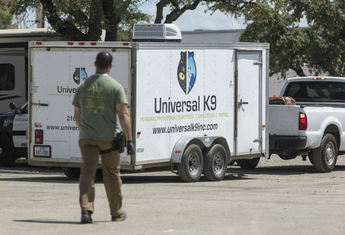 State and federal authorities serve a search warrant Wednesday, Aug. 8, 2018 at canine training facility Universal K9, 15329 Tradesman, near Loop 1604 on the Northwest Side, as part of a federal investigation. Animal Care Services took 27 dogs from the facility as part of the raid.