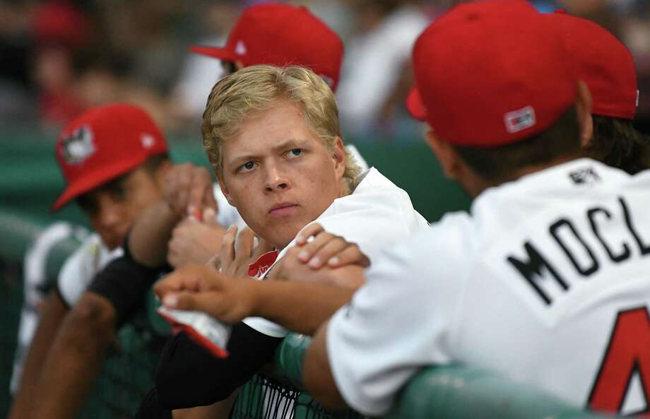 Tri-City ValleyCats pitcher Austin Hansen, center, is seen in the dugout during a baseball game against the Hudson Valley Renegades at Joe Bruno Stadium on Wednesday, Aug. 8, 2018 in Troy, N.Y.  (Lori Van Buren/Times Union) Photo: Lori Van Buren, Albany Times Union / 40044085A