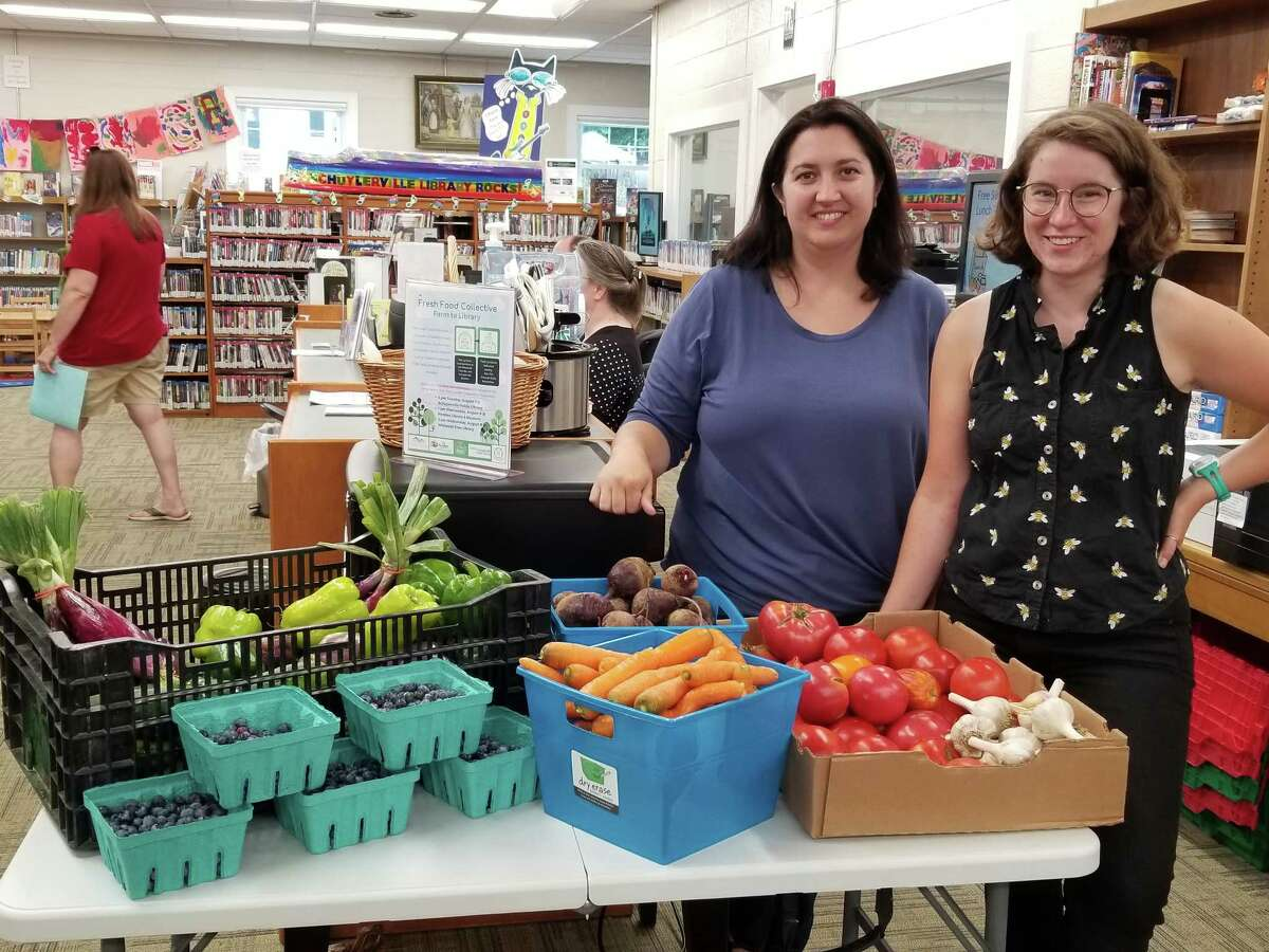 Caitlin Johnson (left) and Lillian Slaughter pose with fresh produce at the Schuylerville Public Library on Tuesday, Aug. 7, to celebrate the launch of Fresh Food Collective Library Distribution. (Submitted photo)