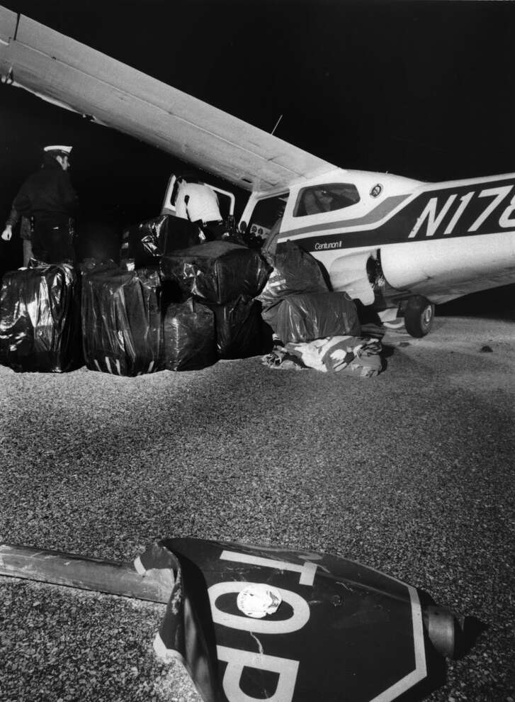 From the Jan. 20, 1976, Houston Chronicle: The pilot of this plane, loaded with about 1,000 pounds of marijuana, fled after he crash landed at 4:50 a.m. today in a Meyerland shopping center parking lot in Houston, Texas.  The plane had taken off 20 minutes earlier from Hobby Airport for an undetermined destination.  Police are looking for the pilot. 