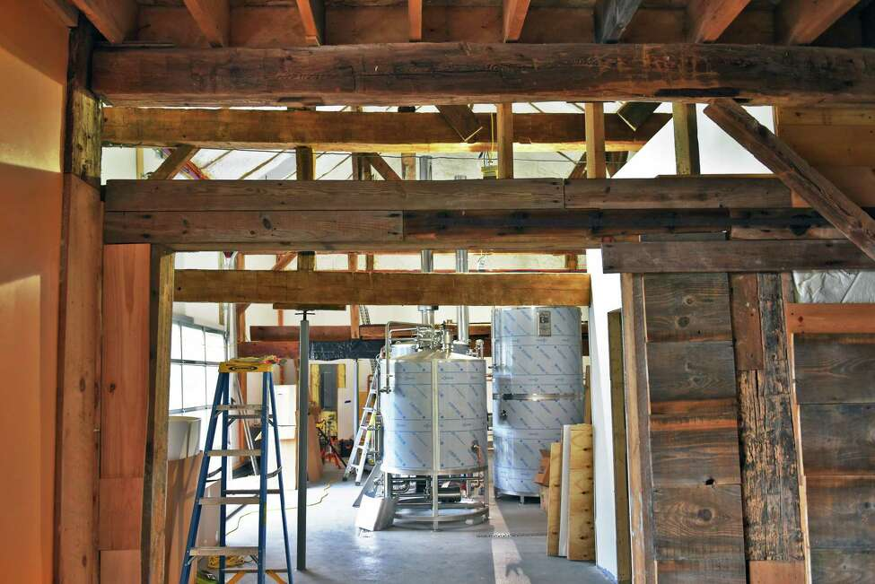 The brewhouse, framed by the original timbers of the 18C barn in owner Brenda Schworm's Back Barn Brewing Co. Friday July 27, 2018 in Duanesburg, NY. (John Carl D'Annibale/Times Union)