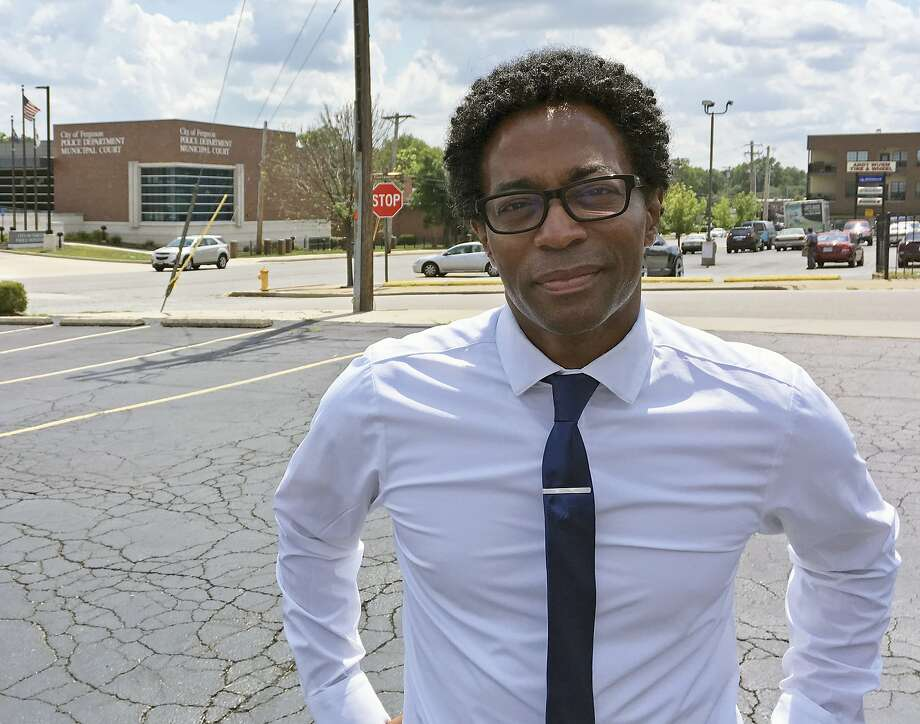 Wesley Bell stands outside the Ferguson, Mo., police headquarters on Wednesday, Aug. 8, 2018, a day after he defeated longtime St. Louis County prosecutor Bob McCulloch in the Democratic primary. Some observers saw the race as a referendum on McCulloch's handling of the fatal police shooting of Michael Brown in 2014.  (AP Photo/Jim Salter) Photo: Jim Salter, Associated Press