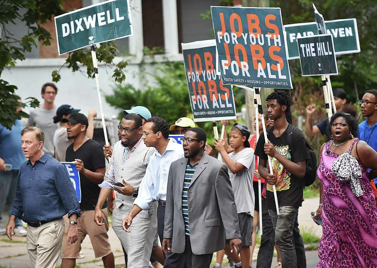 New Haven residents joined gubernatorial candidate Ned Lamont, Pastor Kelcy Steele of Varick Memorial AME Zion Church and Shawn Wooden, candidate for state treasurer, marching through the Dixwell neighborhood in the area where Trayvon Foster was murdered by gunfire earlier this summer, Wednesday, August 8, 2018, focused on youth safety, good jobs, affordable housing. The rally was organized by New Haven Rising and the anti-violence group, Ice the Beef.
