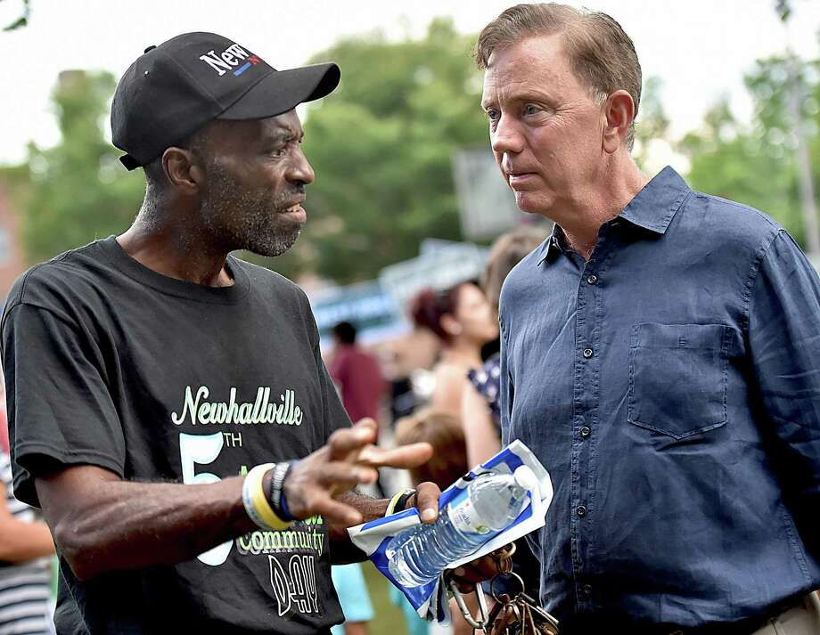 New Haven resident Tyrone Grant talks to Ned Lamont before a  march from Goffe Street Park Wednesday. Photo: Catherine Avalone / Hearst Connecticut Media / New Haven Register