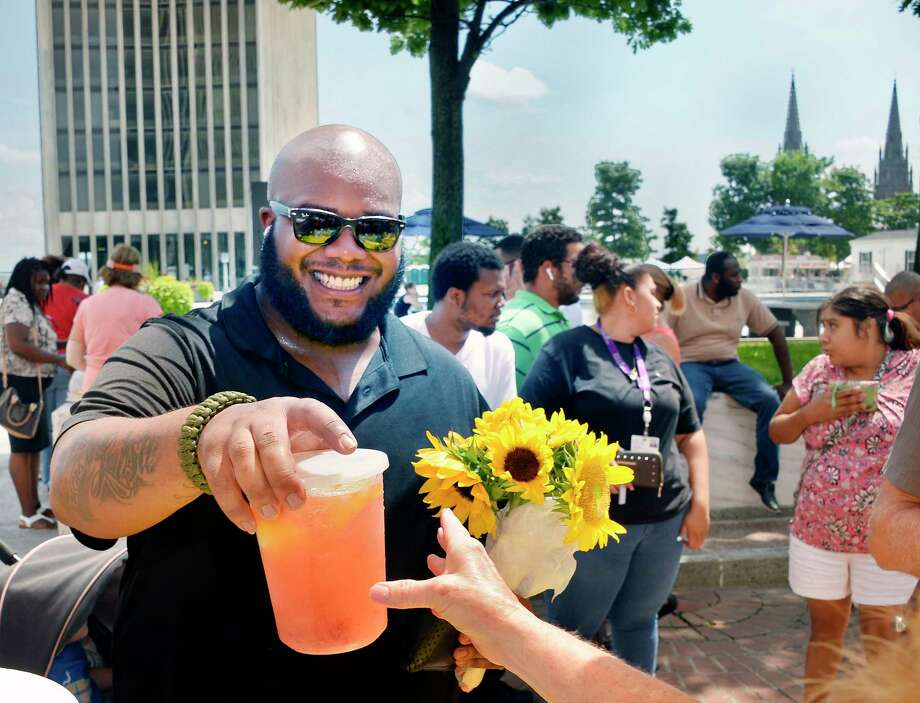 Lavon Spruill of Niskayuna buys a cold strawberry lemonade at the New York State Food Festival on the Empire State Plaza Wednesday August 8, 2018 in Albany, NY.  (John Carl D'Annibale/Times Union) Photo: John Carl D'Annibale / 20044505A