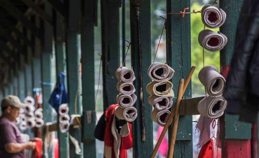 Horse leg wraps are lined up and set for bedding horses down for the evening in the barn area of the Saratoga Race Course Wednesday Aug. 8, 2018 in Saratoga Springs, N.Y.(Skip Dickstein