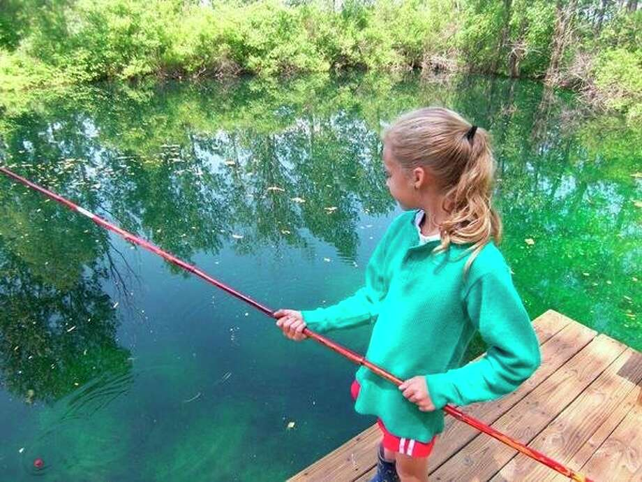A great way to teach kids how to fish is by starting them out with a cane pole, due to its utter simplicity in function. (Tom Lounsbury/Hearst Michigan)