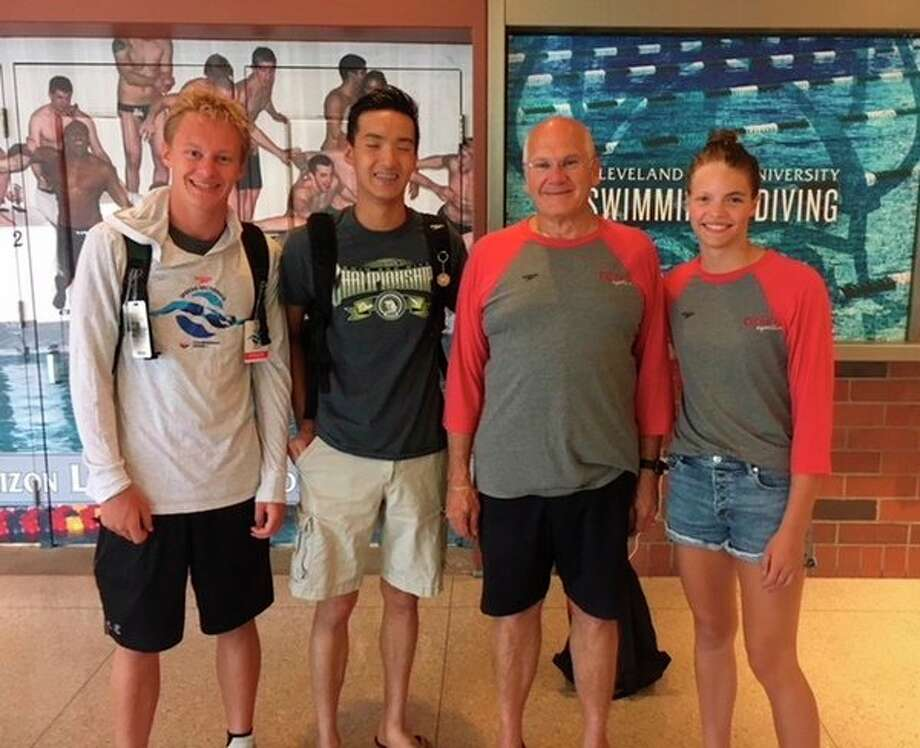 Pictured, from left, are Zach Fewkes, Collin Che, Kronos Aquatics coach Gary Strickler and Claire Newman. Fewkes, Che and Newman competed at the LE Speedo Sectionals at Cleveland State University from July 19-22, along with Gage Bunker and Joe Krzciok, who are not pictured. 				Fewkes, Che and Newman also competed at the Michigan Swimming long course state meet in Ypsilanti a week later, along with Chelsea Fenton and Louie Sun, who are not pictured. (photo provided)