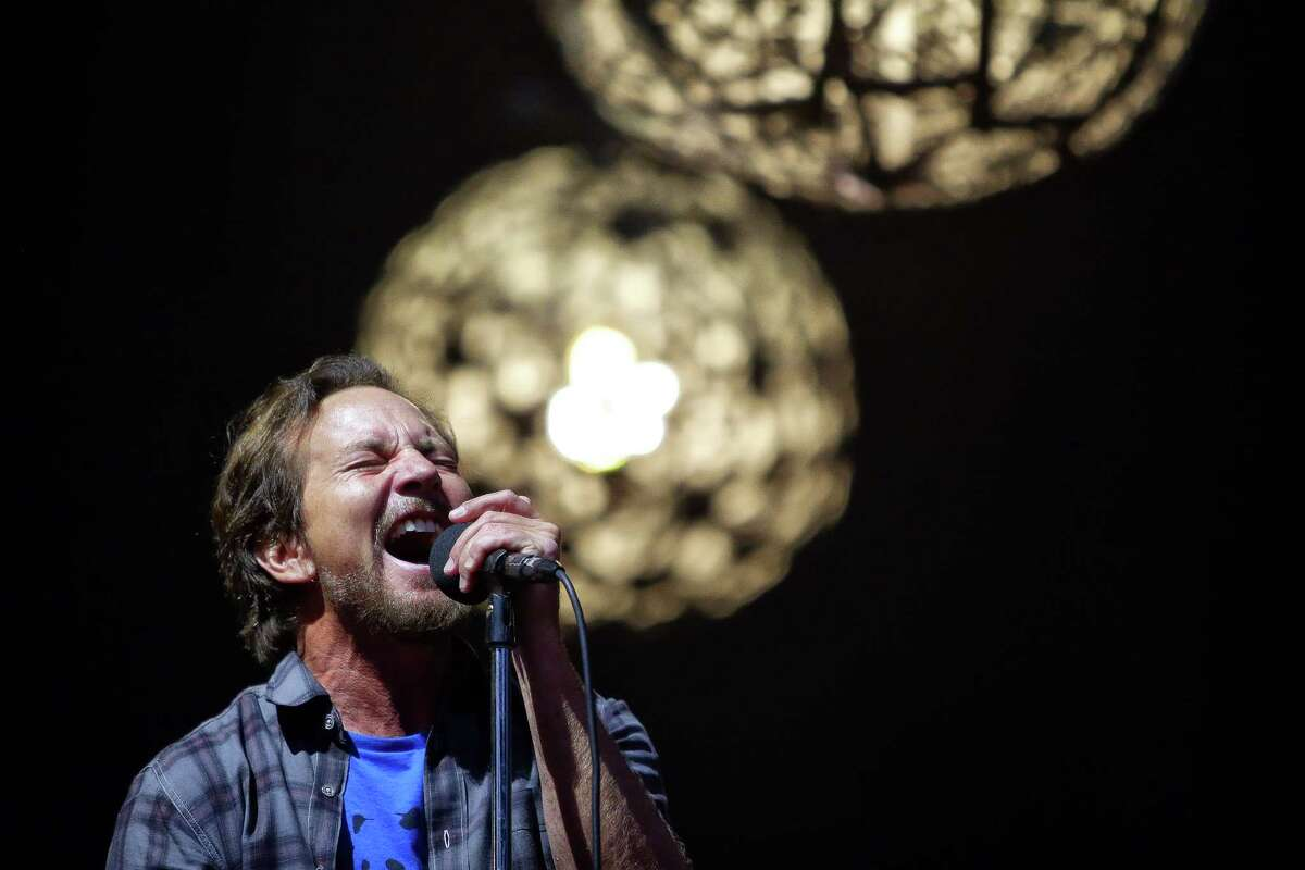Frontman Eddie Vedder performs with Pearl Jam in the first of two sold-out concerts titled The Home Shows at Safeco Field, Wednesday, Aug. 8, 2018. The shows, their first in the band's hometown in five years, are part of a massive fundraising campaign to fight homelessness in King County. The band has already raised over $10 million through community partners.
