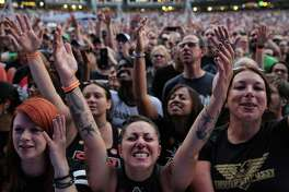 Fans cheer as Pearl Jam plays the first of two sold-out concerts titled The Home Shows at Safeco Field, Wednesday, Aug. 8, 2018. The shows, their first in the band's hometown in five years, are part of a massive fundraising campaign to fight homelessness in King County. The band has already raised over $10 million through community partners.