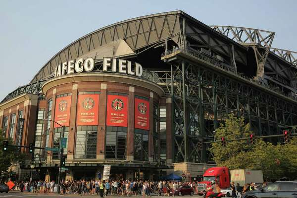 Fans make their way into Safeco Field for the first of two sold-out Pearl Jam concerts, Wednesday, Aug. 2018.