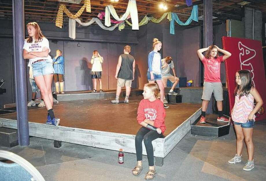 "Members of the cast of Ken Bradbury's musical ""I Wanna Be …"" rehearse at Playhouse on the Square in downtown Jacksonville. Photo:       Angela Bauer 