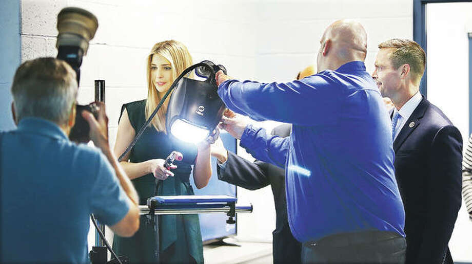 Presidential adviser Ivanka Trump tries her skills Wednesday at a welding simulator during a visit to the new Weber Workforce Development Center at Lewis and Clark Community College. Photo:       John Badman | Hearst Illinois