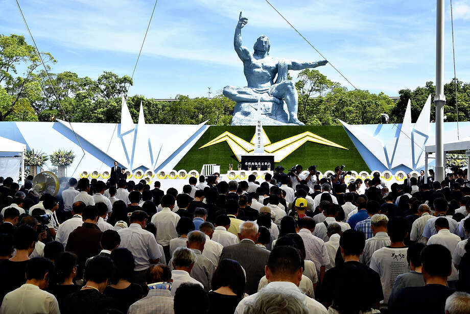 Participants observe a minute's silence at a ceremony in Nagasaki Peace Park on Thursday at 11:02 a.m., the exact time the bomb was dropped on Nagasaki.. Photo: Japan News-Yomiuri / Japan News-Yomiuri
