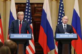 President Donald Trump, left, listens as Vladimir Putin, Russia's president, speaks during a news conference in Helsinki, Finland, on July 16, 2018.