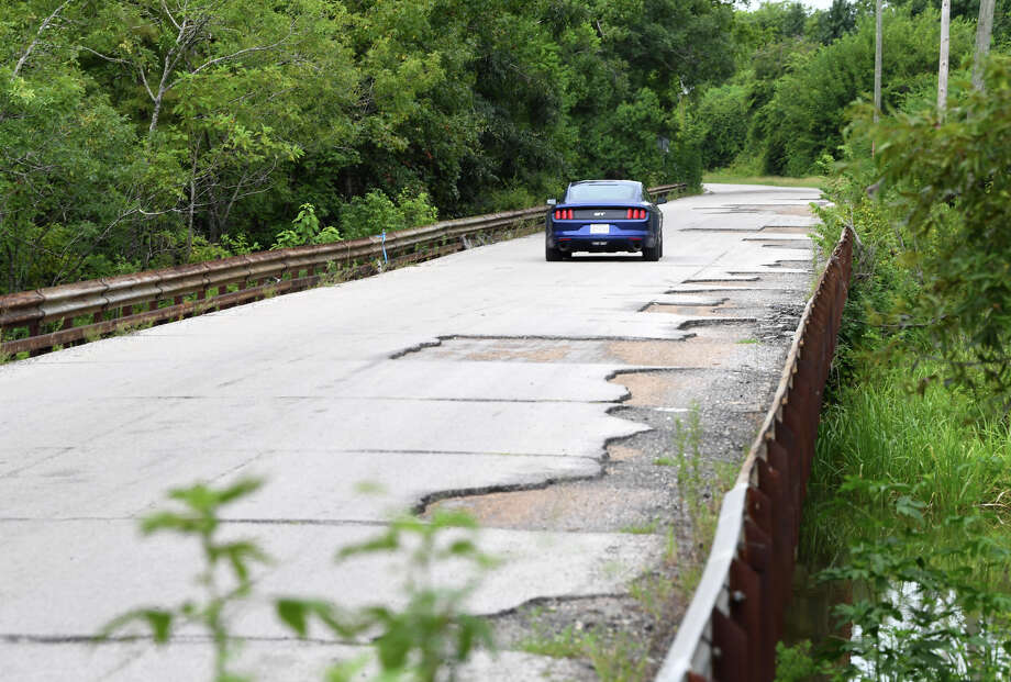 A car travels in the middle of the Baird's Bayou bridge on U.S. 90 in Rose City to avoid pavement damaged by flooding from Tropical Storm Harvey. The Texas Department of Transportation will close the road for about two years to make repairs to the bridge.  Photo taken Wednesday, 8/8/18 Photo: Guiseppe Barranco/The Enterprise / Guiseppe Barranco ?