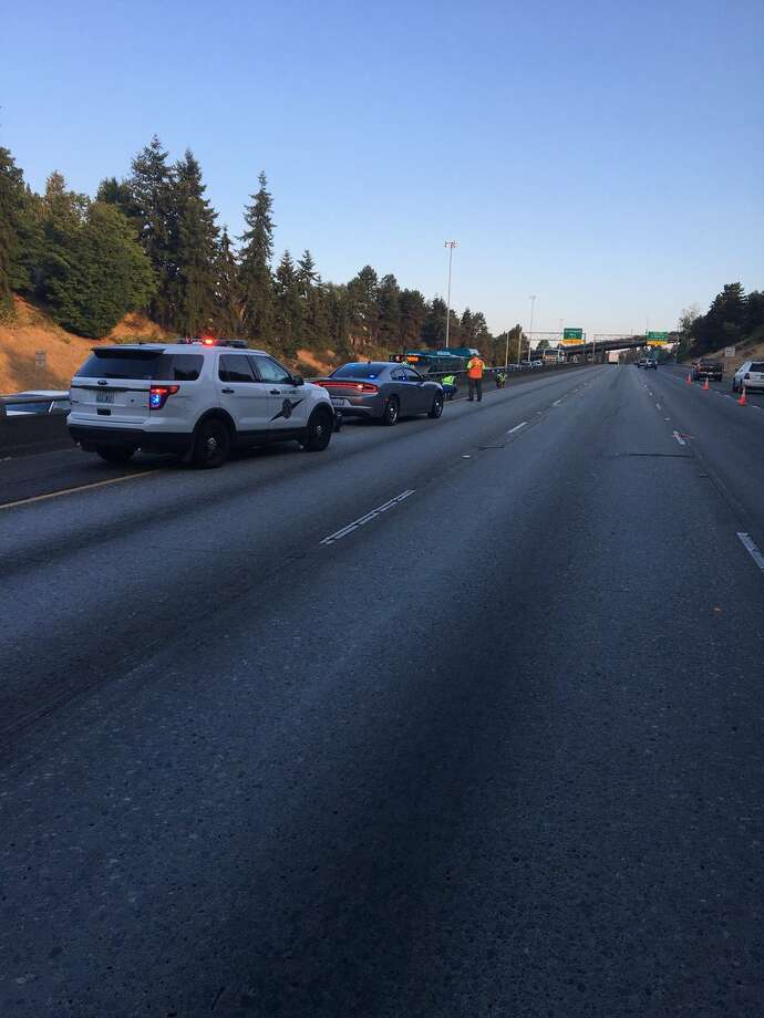 The State Patrol investigates a death scene on northbound Interstate 5 near Northeast 85th Street. A woman reportedly jumped from an overpass and died, reports say. The investigation blocked most lanes of freeway traffic. Photo: State Patrol