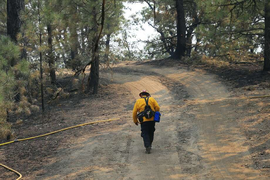 A firefighter hikes up a trail in an area burned by the Ranch Fire near Clear Lake. Photo: Jim Wilson / New York Times