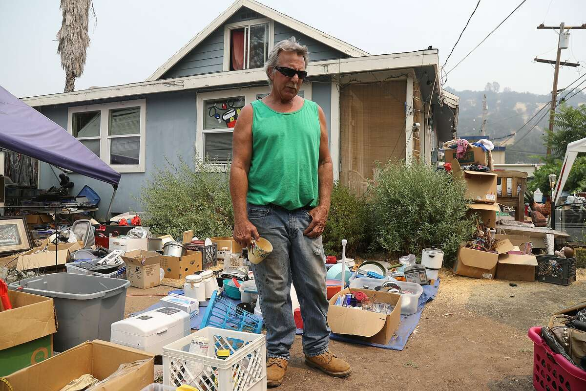 Steve Bauer, who defied evacuation orders when the Ranch fire swept through the area, at home with goods he sells from abandoned storage lockers, around Clearlake, Calif., Aug. 8, 2018. The Mendocino Complex fire system, a combination of the Ranch fire and the River fire, has grown to more than 300,000 acres. Billowing smoke from the historic wildfire season has caused hazardous air conditions across the state, prompting air quality alerts and forcing many residents to take refuge indoors to avoid unhealthy exposure to bad air. (Jim Wilson/The New York Times)