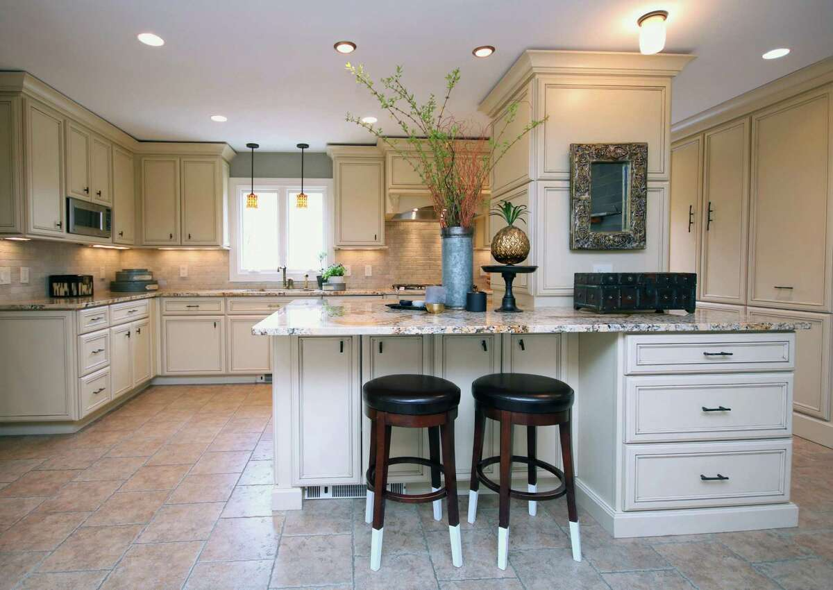In the gourmet kitchen there is ceramic tile flooring, granite counters ?- including a breakfast bar for three, custom cabinetry, oversized sink, and high-end appliances.