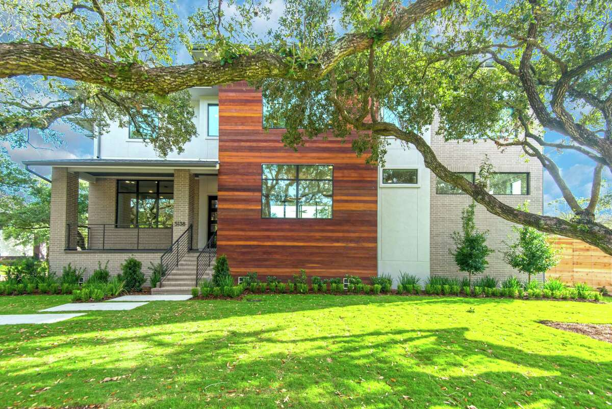Brick and Cumaru wood make up much of the exterior of the Meyerland home of Cory and Carley Giovanelli. Their builder was On Point Custom Homes. The home will be on the Sept. 22 Modern Architecture + Design Society Home Tour.