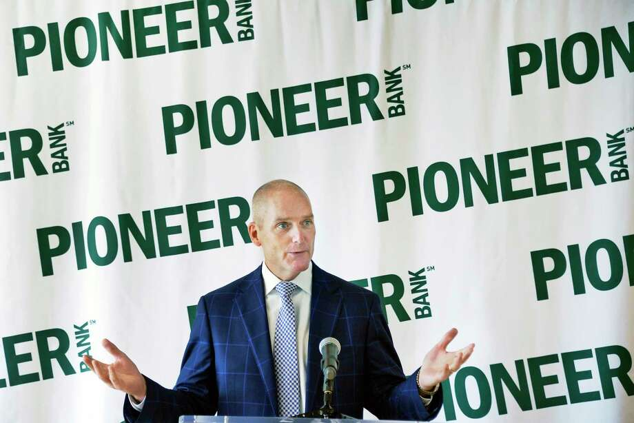 Pioneer Bank president and CEO Tom Amell, right, announces the launch of the Pioneer Bank Foundation to benefit local charities Thursday August 9, 2018 in Colonie, NY.  (John Carl D'Annibale/Times Union) Photo: John Carl D'Annibale, Albany Times Union / 20044525A
