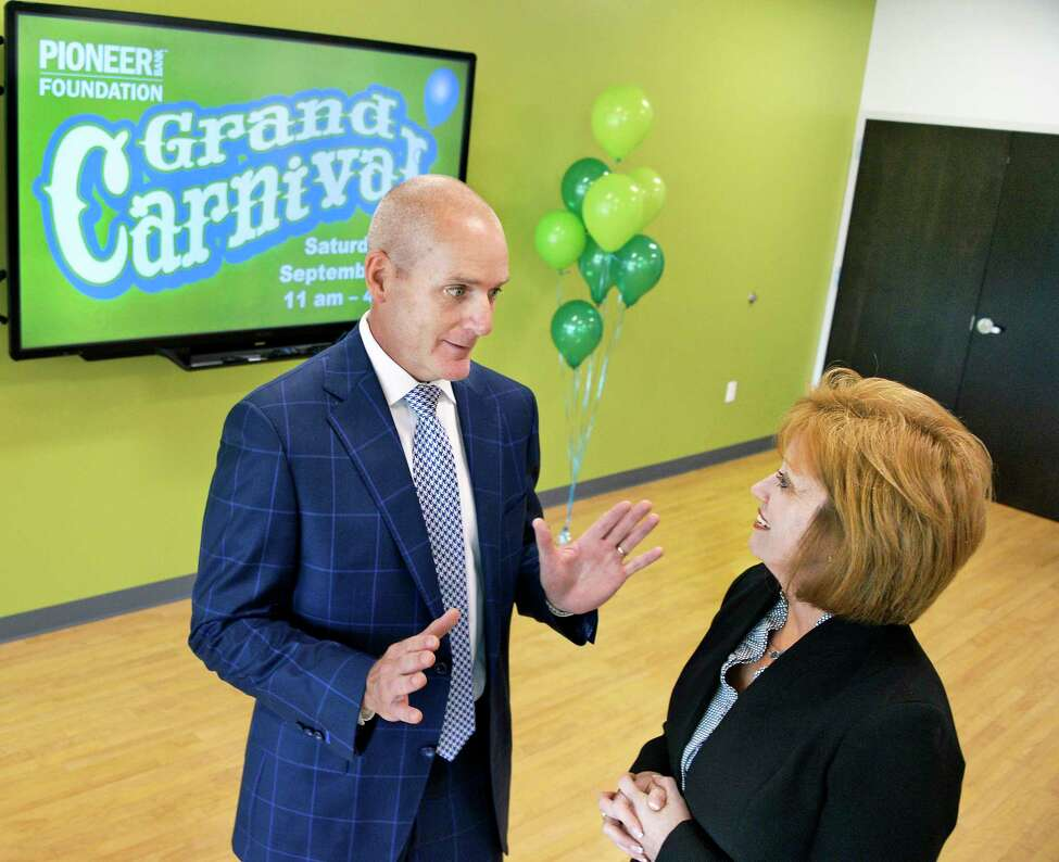 Pioneer Bank president and CEO Tom Amell and CARES of NY board president Audra Higgins during the announcement of the launch of the Pioneer Bank Foundation to benefit local charities Thursday August 9, 2018 in Colonie, NY. (John Carl D'Annibale/Times Union)