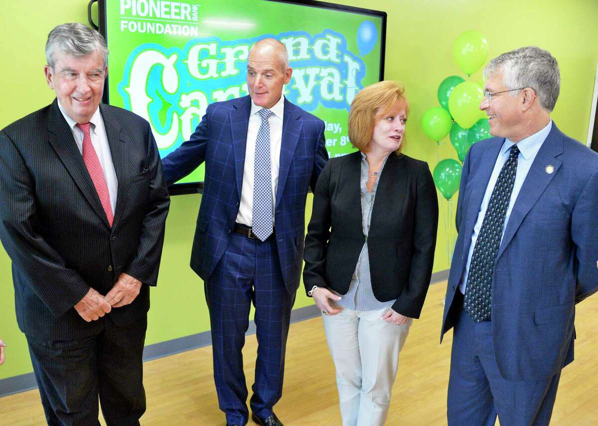 From left: Senator Neil Breslin, Pioneer Bank president and CEO Tom Amell, CARES of NY board president Audra Higgins and Assemblyman Phil Steck during the announcement of the launch of the Pioneer Bank Foundation to benefit local charities Thursday August 9, 2018 in Colonie, NY. (John Carl D'Annibale/Times Union)