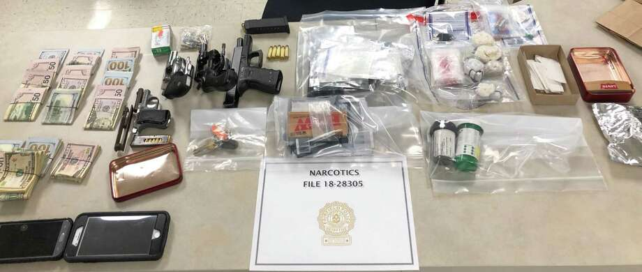 Police seized drugs, guns and cash after a month-long investigation into drug sales in Fairfield and Bridgeport. Fairfield, CT. 8/10/18 Photo: Contributed / Contributed Photo / Fairfield Citizen