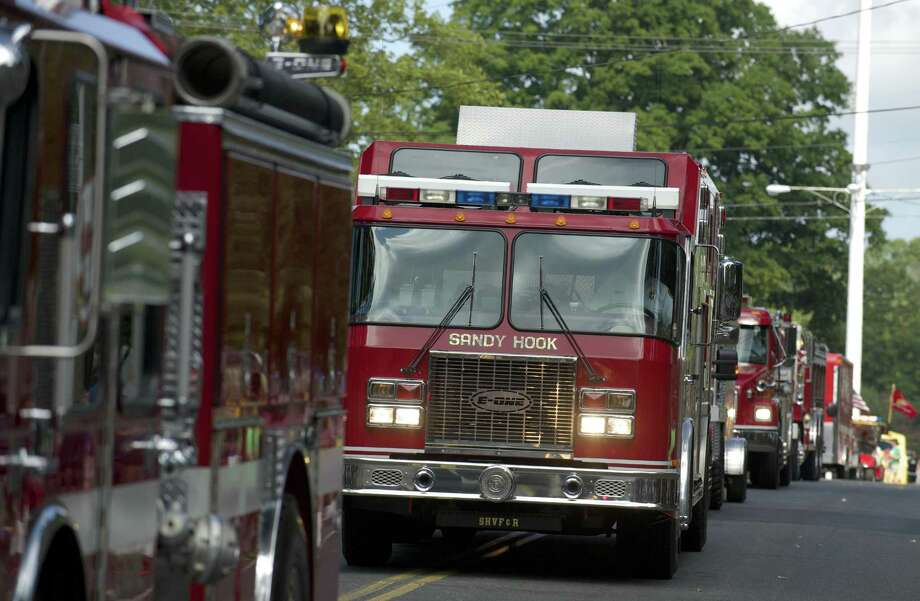 Trucks from Sandy Hook Volunteer Fire & Rescue Company during a recent Labor Day Parade in Newtown. Photo: H John Voorhees III / H John Voorhees III / The News-Times Freelance