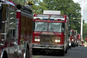 Trucks from Sandy Hook Volunteer Fire & Rescue Company during a recent Labor Day Parade in Newtown.