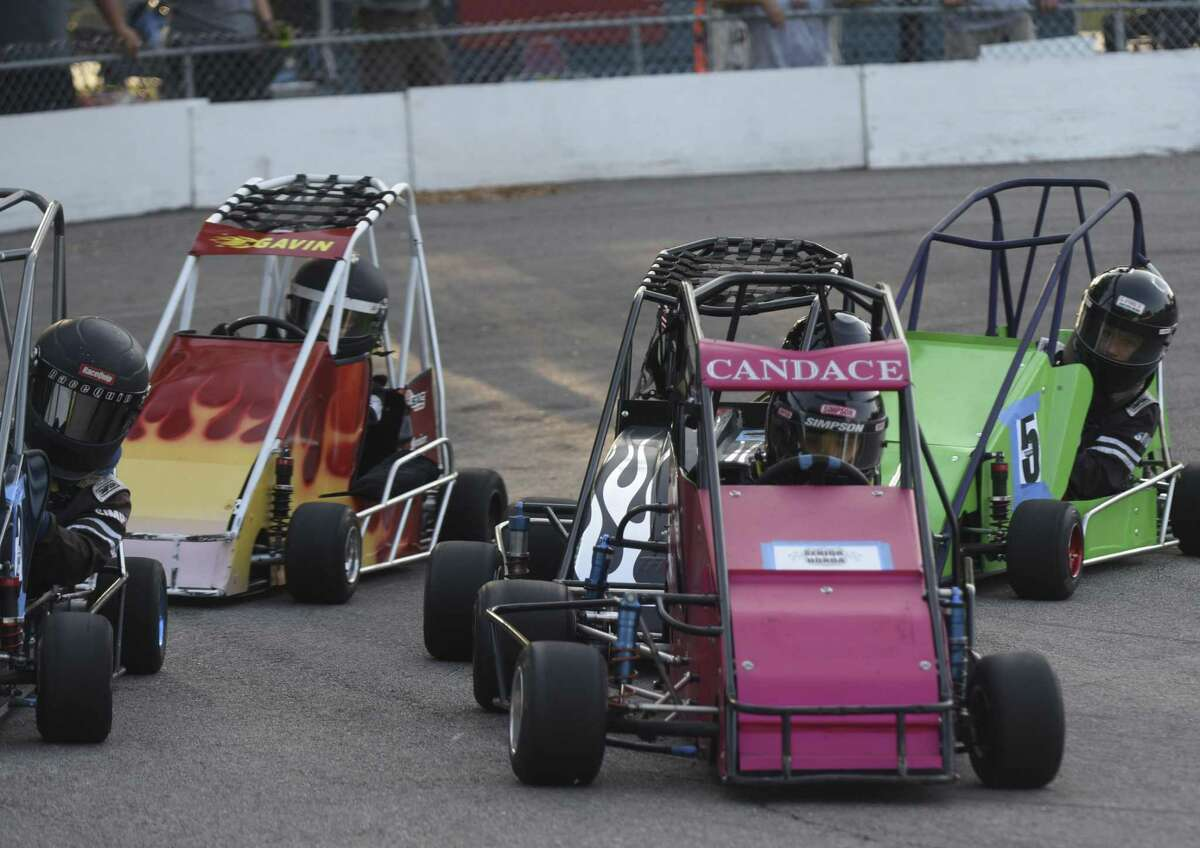 Candace West takes the lead during a senior Honda level race. Like other extracurricular activities, quarter midget racing teaches young kids the thrill of competition, the importance of teamwork and, inevitably, how to handle the sting of losing.