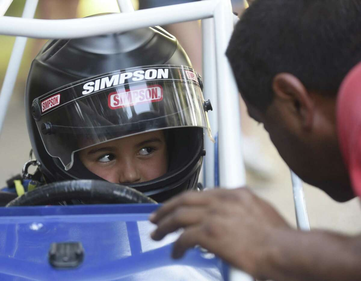 Zain Inskeep, 5, receives encouragement from his grandfather, Francisco Prieto, before his race.