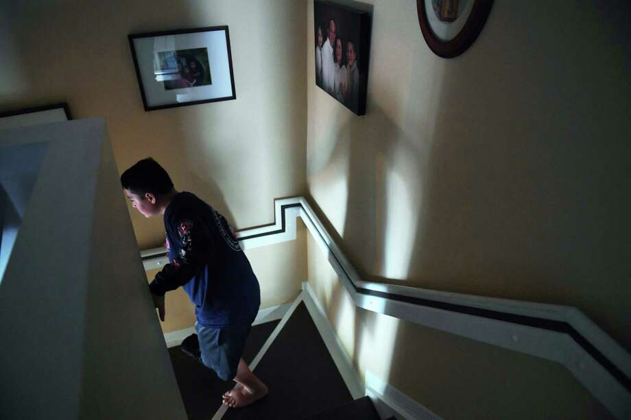 Kyle Laman, 15, in April at his home in Coral Springs, Fla. Kyle was wounded in the February mass shooting at Marjory Stoneman Douglas High School and wears a protective boot on his right foot. Photo: Washington Post Photo By Matt McClain. / The Washington Post