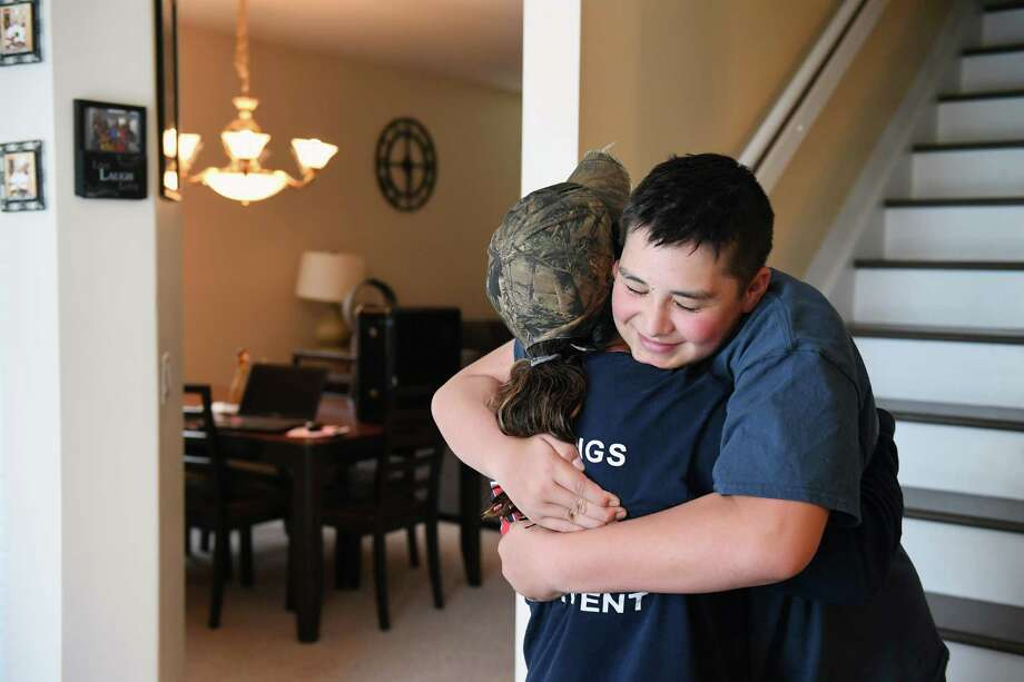 Kyle hugs Marianne Sheehan, a Vermont firefighter who has befriended Kyle and other students at Stoneman Douglas High. Photo: Washington Post Photo By Matt McClain. / The Washington Post