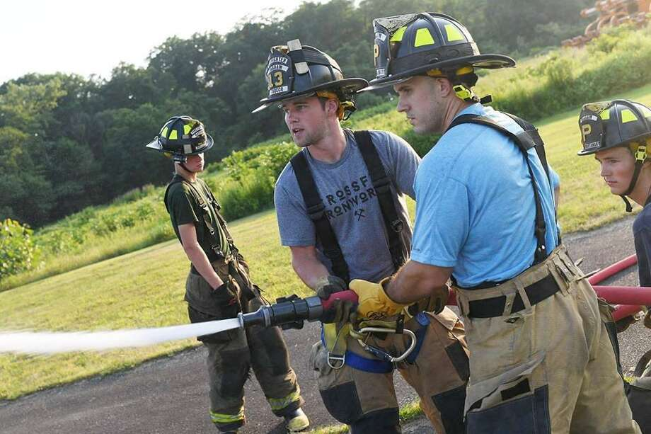 Haddam Volunteer Fire Company responded to 54 calls for emergency services in July. During a weekly drill night July 16, members practiced water pumping and hand-line operations at Eagle's Landing State Park. Photo: Olivia Drake Photo