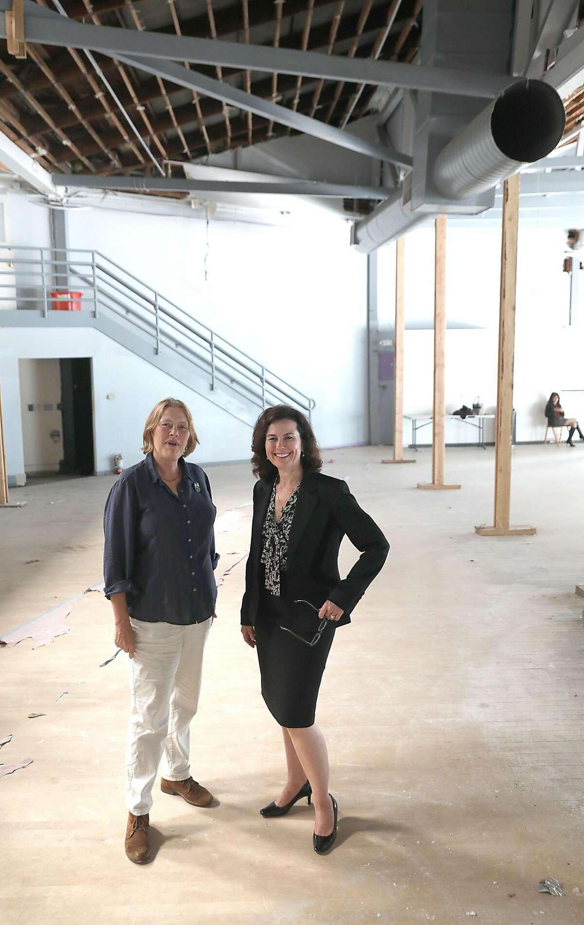 Smuin managing director Lori Laqua (left) and Smuin artistic director Celia Fushille (right) show their new headquarters and dance studio on Tuesday, Aug. 7, 2018 in San Francisco, Calif. Smuin Ballet is celebrating its upcoming 25th anniversary and buying the old Metronome Ballroom on Potrero Hill to convert into its headquarters and dance studio.