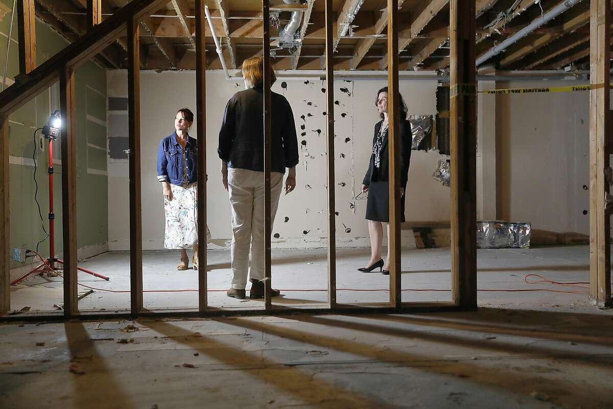 Smuin dancer Erin Yarborough-Powell (left), managing director Lori Laqua (middle) and Smuin artistic director Celia Fushille (right) view where dressing and wellness rooms will be in their new headquarters and dance studio on Tuesday, Aug. 7, 2018 in San Francisco, Calif. Smuin Ballet is celebrating its upcoming 25th anniversary and buying the old Metronome Ballroom on Potrero Hill to convert into its headquarters and dance studio.